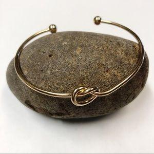 Jewelry - Goldtone knot bracelet.